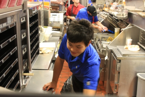 One solution to the worker shortage (Sidney) McDonald's has resorted to is hiring foreign workers on J-1 visas. Pictured here is Jimmy Yang, 20, from Guangdong, China. At home, he studies electrical engineering. His boss said Yang keeps a positive attitude and is a good worker. (Susan Minichiello | Sidney Herald.)