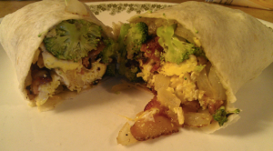 The perfect breakfast burrito has a sinfully decadent texture from a blend of vegetables, eggs, bacon and cheese.